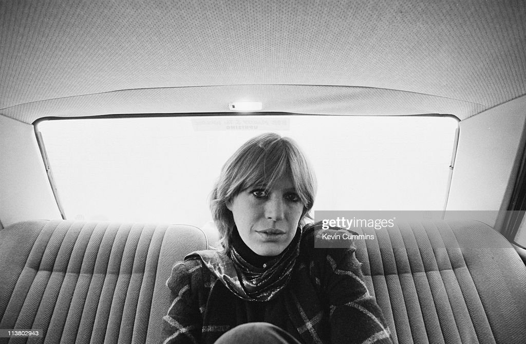 English singer and actress Marianne Faithfull in the back seat of a car, Manchester, November 1981.