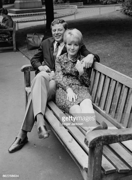English singer and actress Petula Clark with her husband Claude Wolff on a park bench in London UK 6th June 1966 She is in the capital for a fourweek...