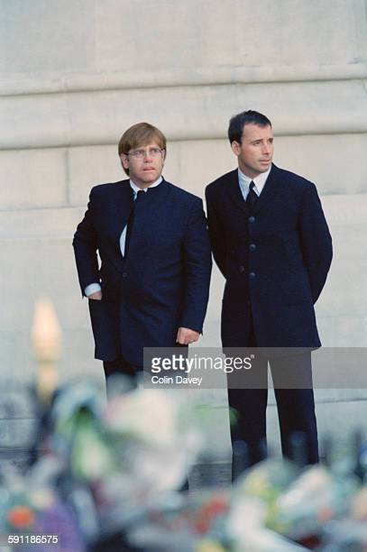 English singer and composer Elton John and his partner David Furnish attend the funeral of Diana Princess of Wales at Westminster Abbey in London 6th...