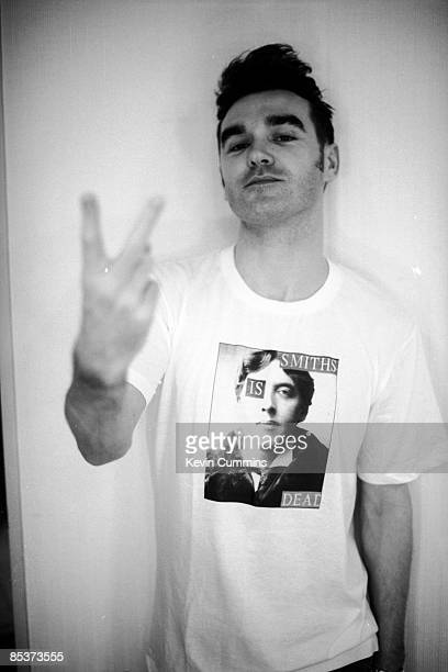 English singer and lyricist Morrissey gives a Vsign during the Japanese leg of his 'Kill Uncle' tour 27th August 3rd September 1991 He is wearing an...