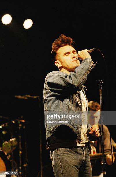 English singer and lyricist Morrissey in concert with The Smiths circa 1987 Guitarist Craig Gannon is in the background