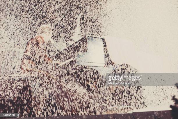 English singer and songwriter Elton John performing in a shower of confetti during his Christmas show at the Hammersmith Odeon London 21st December...