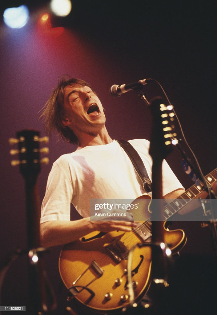 English singer and songwriter Paul Weller performing on stage, circa 1995.
