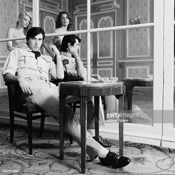 English singer Bryan Ferry of Roxy Music with backing vocalists The Roxettes Doreen Chanter and Jacqui Sullivan at the Montcalm Hotel London 31st...