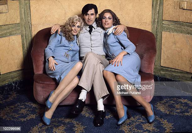English singer Bryan Ferry with Roxy Music vocalists Doreen Chanter and Jacqui Sullivan at the Montcalm Hotel London 31st October 1975 The ladies are...