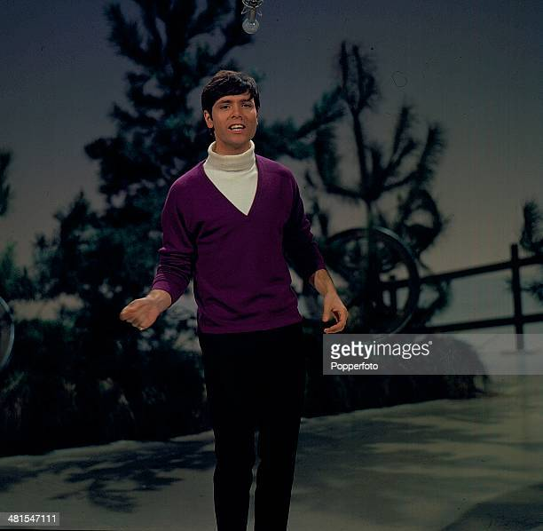 1968 English singer Cliff Richard performs on the television series 'The Morecambe and Wise Show' in 1968