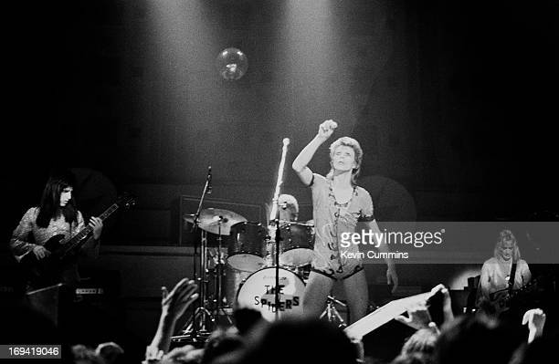 English singer David Bowie performs on stage with bass player Trevor Bolder drummer Mick 'Woody' Woodmansey and guitarist Mick Ronson at Free Trade...