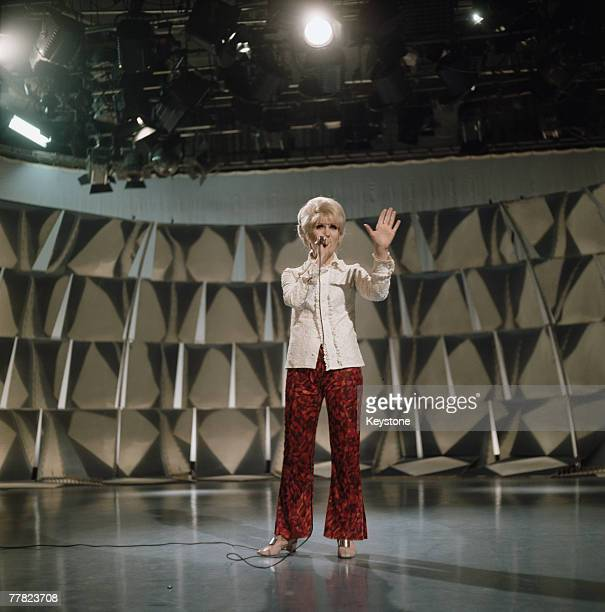 English singer Dusty Springfield performing during a rehearsal at a television studio circa 1966