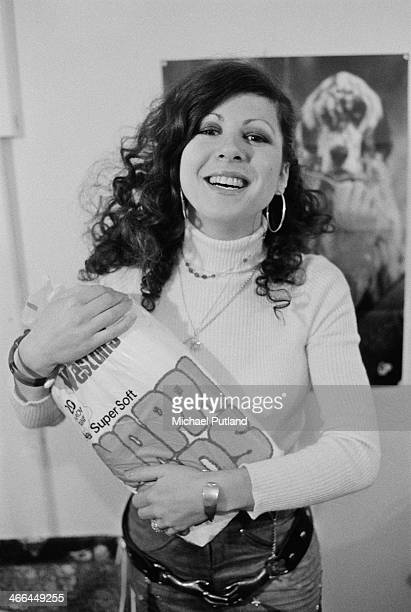 English singer Elkie Brooks holding a pack of nappies London March 1974