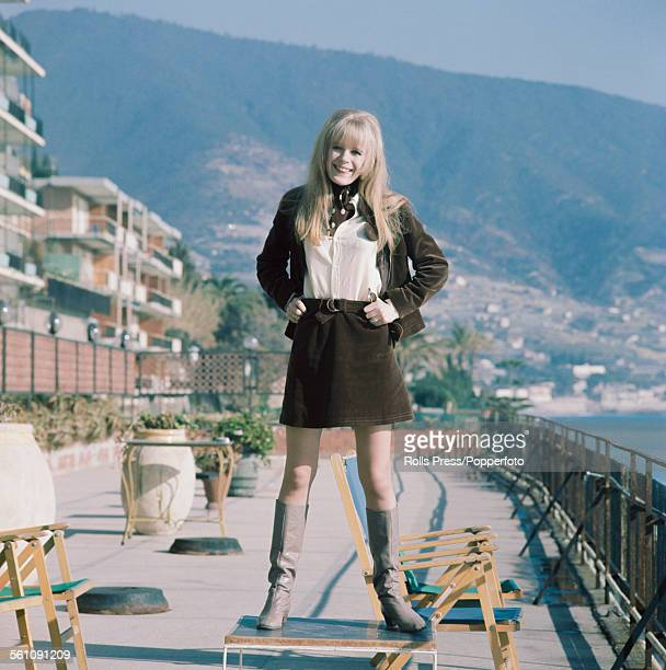 English singer Marianne Faithfull posed wearing a cord jacket and matching skirt with grey knee length boots in Sanremo Italy before her appearance...