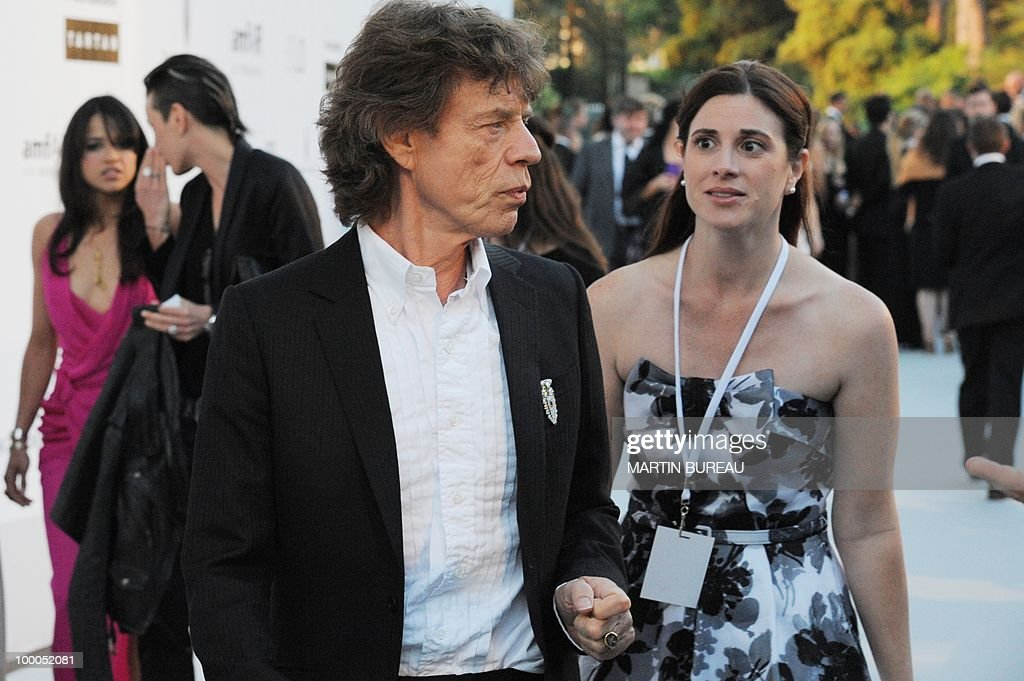 English singer Mick Jagger poses while arriving to attend the 2010 amfAR's Cinema Against Aids on May 20, 2010 in Antibes, southeastern France.