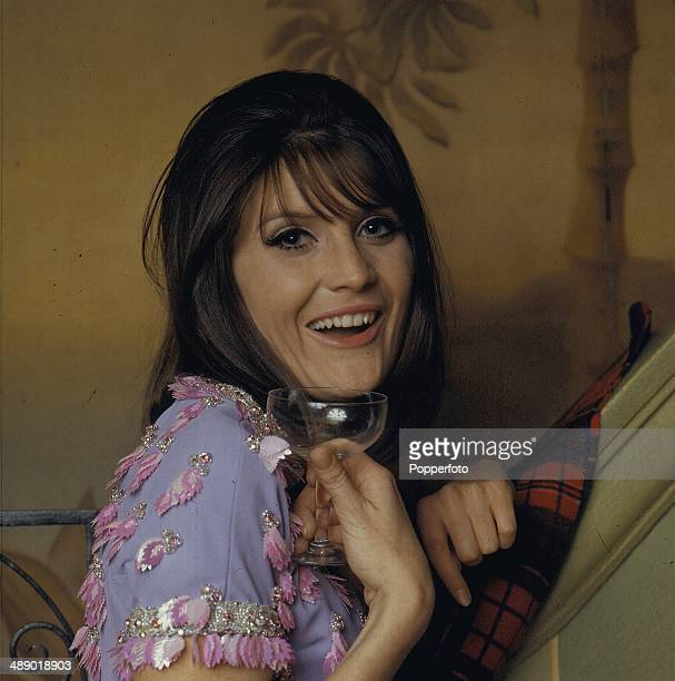 English singer Sandie Shaw posed holding a wine glass in 1966