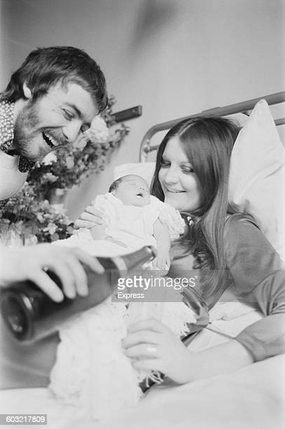 English singer Sandie Shaw with her husband Welsh fashion designer Jeff Banks and their new baby daughter Gracie at Lewisham Hospital in London UK...