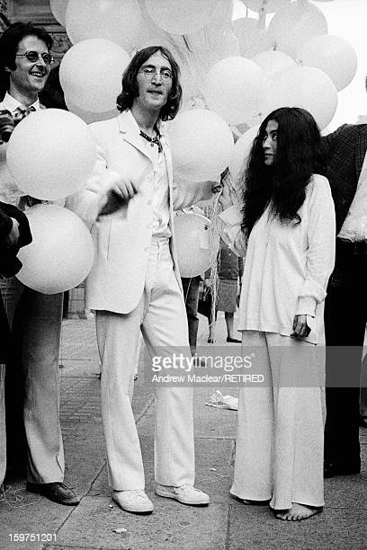 English singer songwriter and musician John Lennon and his girlfriend Yoko Ono outside the Robert Fraser Gallery in London July 1968 Lennon is...