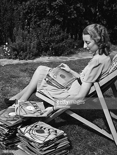 England WWII Forces Sweetheart singer Vera Lynn poses for a photoshoot at her home Sitting in a deck chair in the garden Vera sorts through a large...