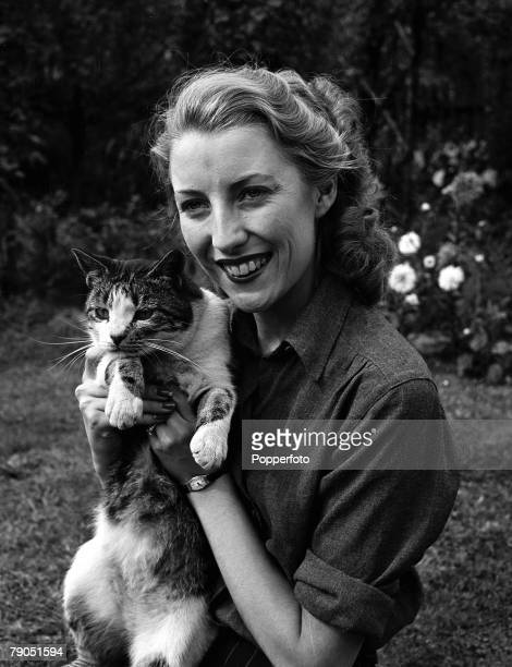 England WWII Forces Sweetheart singer Vera Lynn poses for a photoshoot at her home Vera clutches the family tabby cat
