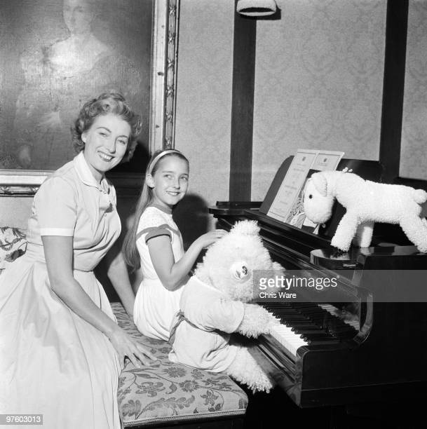 English singer Vera Lynn with her daughter Virginia at the piano September 1956
