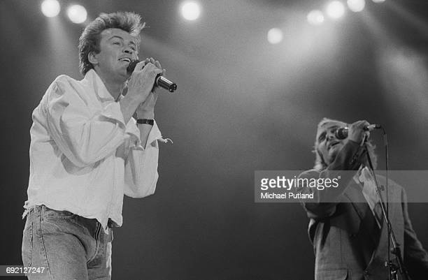 English singers Paul Young and Phil Collins performing at the Prince's Trust Concert Wembley Arena London 6th June 1987