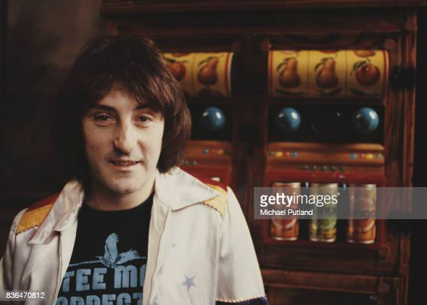 English singersongwriter and former Wings and Moody Blues guitarist Denny Laine poses in front of two slot machines in 1981
