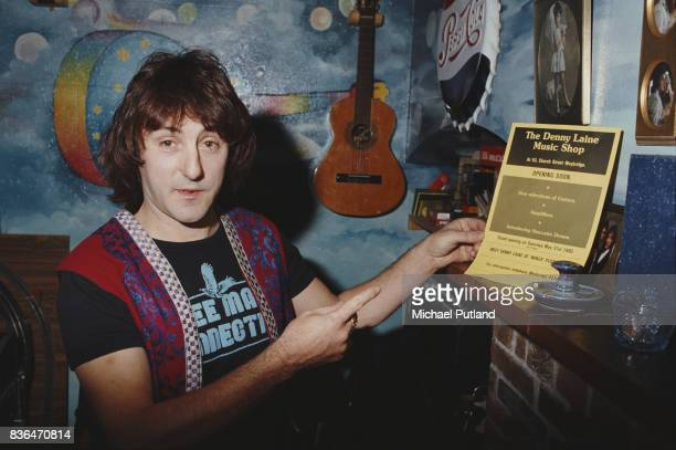 English singersongwriter and former Wings and Moody Blues guitarist Denny Laine shows his memorabilia including a leaflet of 'The Denny Laine Music...