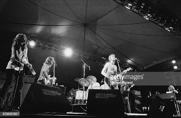 English singersongwriter and guitarist Eric Clapton performing during his US tour July 1974 Left to right Yvonne Elliman George Terry Clapton Carl...