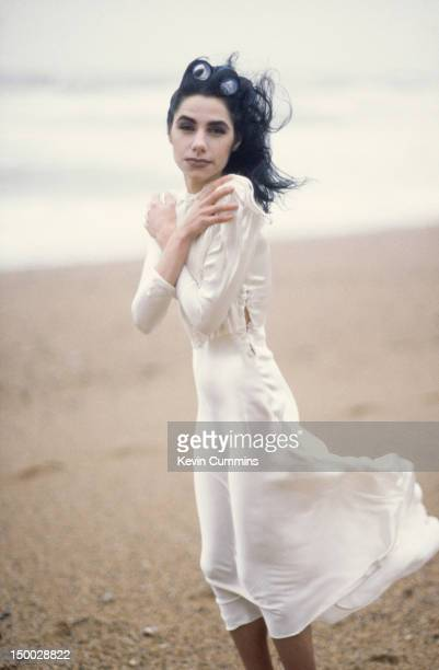English singersongwriter and guitarist PJ Harvey on a beach in Dorset January 1995