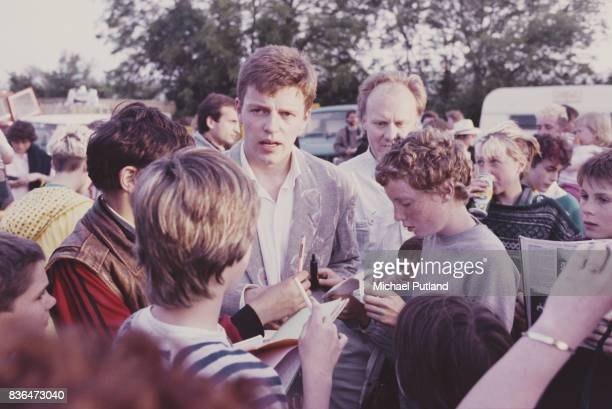 English singersongwriter and musician Graham 'Suggs' McPherson of Ska band Madness meets fans circa 1981