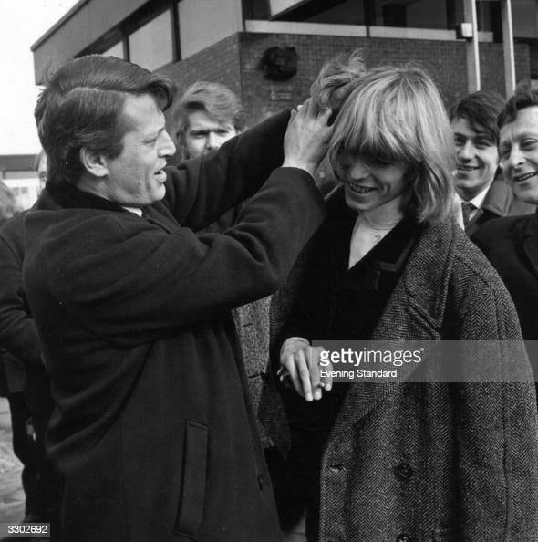 Brixton born pop singer and songwriter David Jones who found major success in the 1970's after changing his name to David Bowie has his hair ruffled...