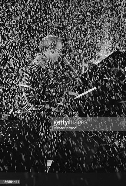 English singersongwriter Elton John performing in a shower of confetti during his Christmas show at the Hammersmith Odeon London 21st December 1973