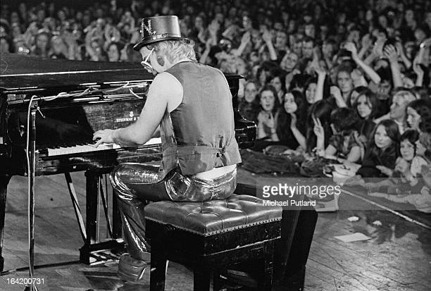English singersongwriter Elton John performing on stage 1973