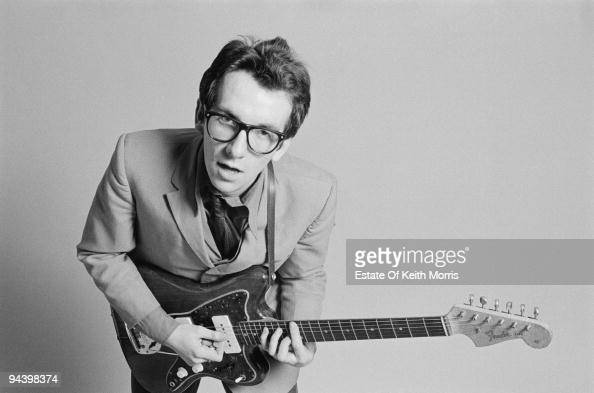 English singersongwriter Elvis Costello with a Fender Jazzmaster guitar March 1977 A photoshoot for the cover of his debut album 'My Aim Is True'