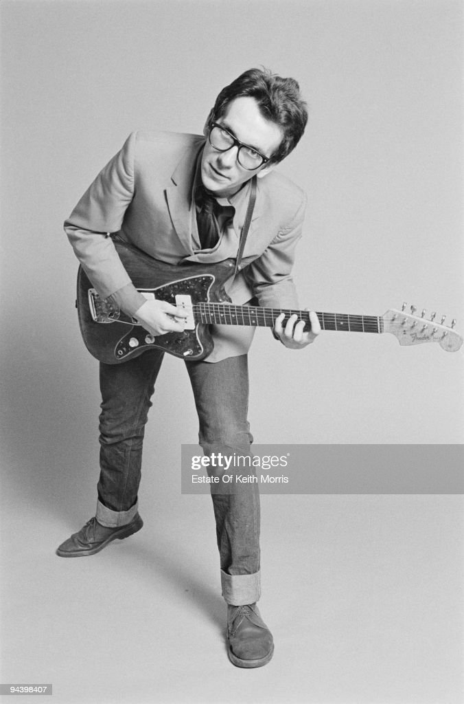 English singer-songwriter Elvis Costello with a Fender Jazzmaster guitar, March 1977. A photoshoot for the cover of his debut album 'My Aim Is True'.