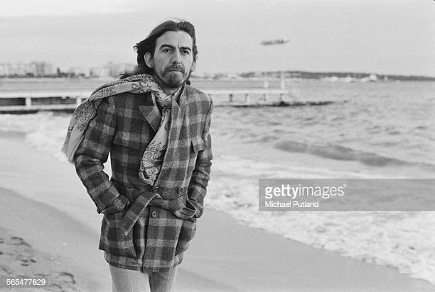 English singersongwriter guitarist and former Beatle George Harrison on the beach in Cannes France 30th January 1976 Harrison is in Cannes for the...
