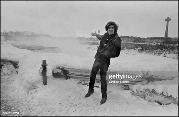English singersongwriter Nick Lowe poses at a frozen Niagara Falls in minus 40 degree temperatures New York March 1978