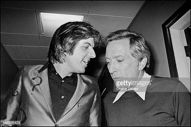English singersongwriter Nick Lowe with American singer Andy Williams backstage at a recording of the BBC TV show 'Top Of The Pops' London March 1978