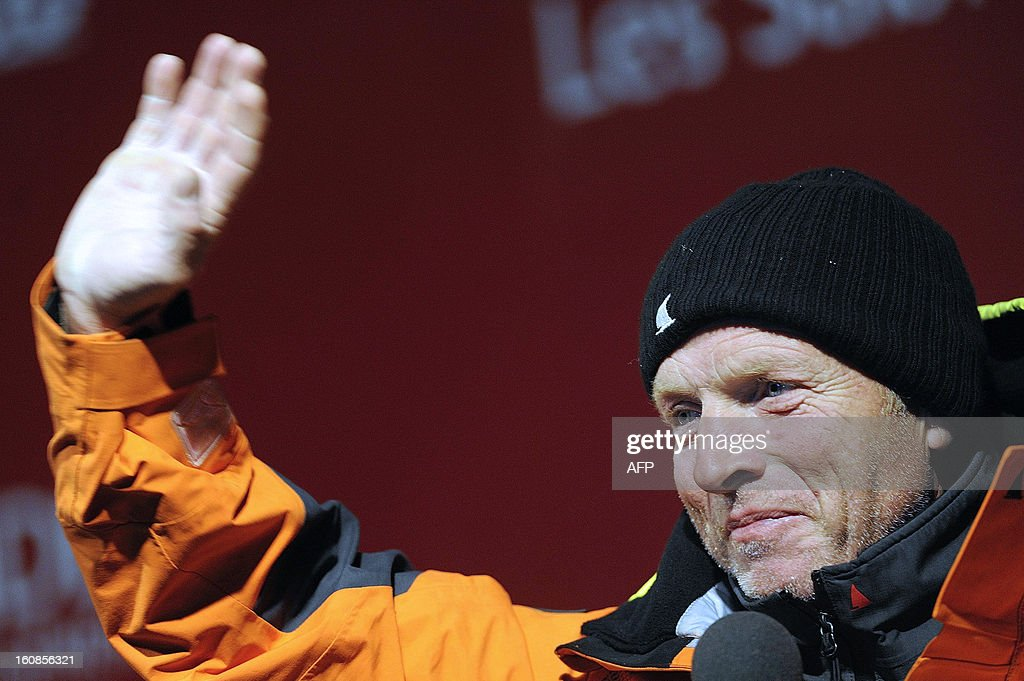 English skipper Mike Golding waves upon his arrival late on February 6, 2013 in Les Sables d'Olonne, western France, finishing sixth of the 7th edition of the Vendee Globe solo round-the-world race.
