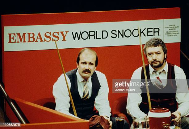 English snooker players Willie Thorne and John Virgo during their first round match at the World Snooker Championship at the Crucible Theatre...