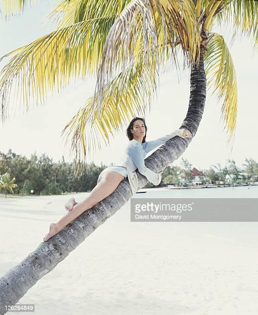 English socialite and columnist Tara PalmerTomkinson posing on a palm tree at a beach 1998