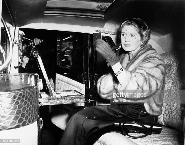 English socialite Norah Docker Lady Docker poses for the press inside her new silver plated Hooper bodybuilt Daimler limousine at the Earls Court...