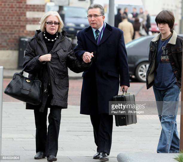 English solicitor Victor Barker who lost his son James in the Omagh bomb explosion with his wife DonnaMarie and son Oliver arrive at Belfast High...