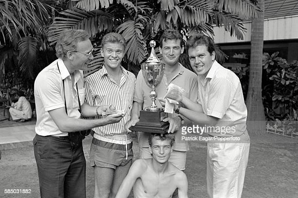 English sports photographers posing with the Cricket World Cup trophy following the World Cup Final between England and Australia at Eden Gardens in...