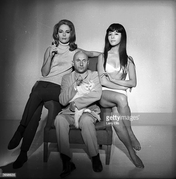 English stage and film actor Donald Pleasence with Karin Dor and Mie Hama in a James Bond photocall from 'You Only Live Twice' in which he plays the...
