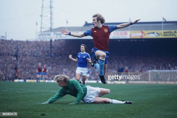 English striker Andy Gray of Aston Villa leaps over Birmingham City goalkeeper Jim Montgomery after scoring the only goal of the match circa 1978