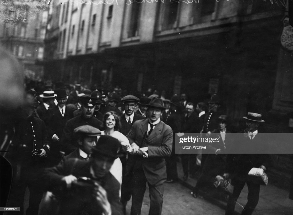English suffragette Annie Kenney (1879 - 1953) is arrested during a demonstration.