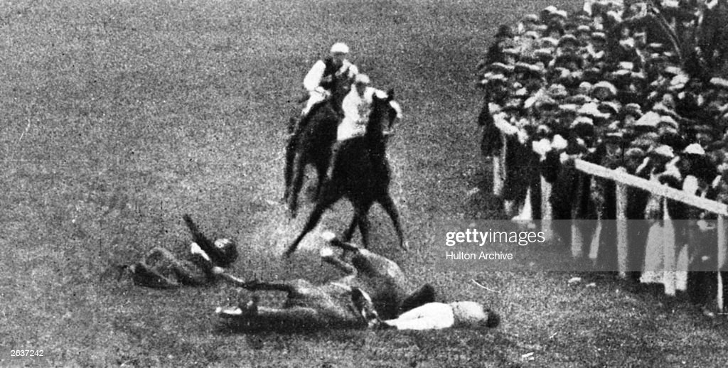 English Suffragette Emily Davison (1872 - 1913) throws herself under King George V's horse, 'Anmer', at the Epsom Race Course.