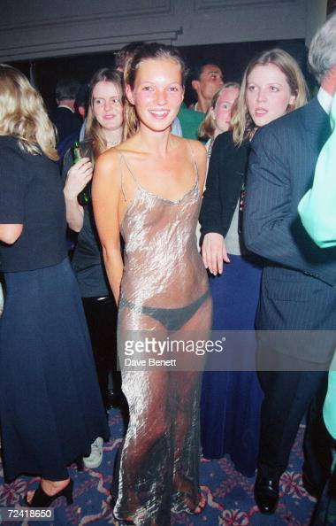 English supermodel Kate Moss wearing a diaphanous silver dress at the Elite Model Agency party for the Look of the Year Contest at the Hilton Hotel...