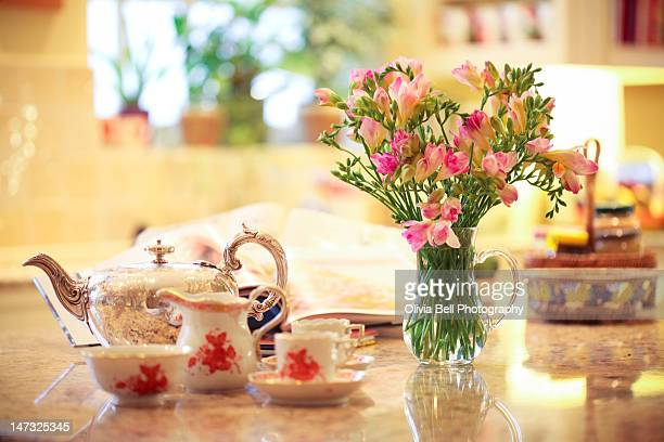 English tea with flowers in kitchen