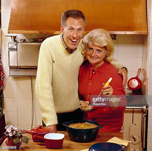 English television presenter and entertainer Bruce Forsyth pictured with his wife Penny Calvert in their kitchen at home in 1964