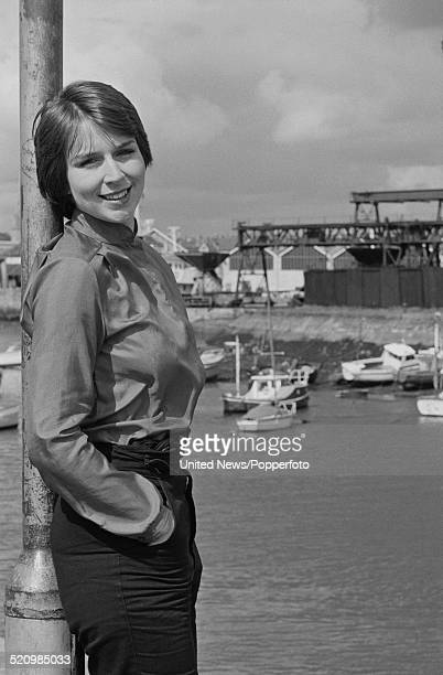 English television presenter and newsreader Fern Britton pictured standing on a harbour wall in Plymouth England on 17th June 1980