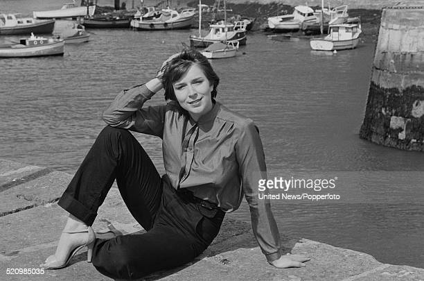 English television presenter and newsreader Fern Britton pictured on a harbour wall in Plymouth England on 17th June 1980